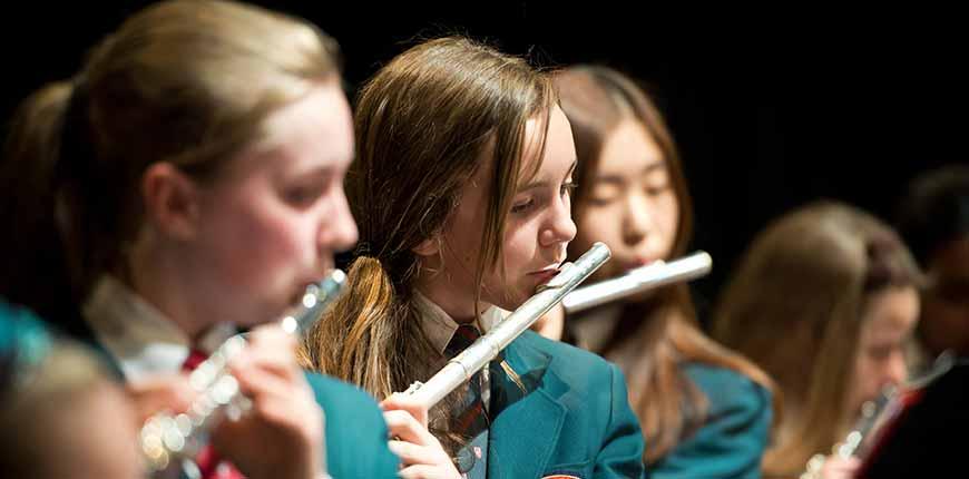 Girls playing flute